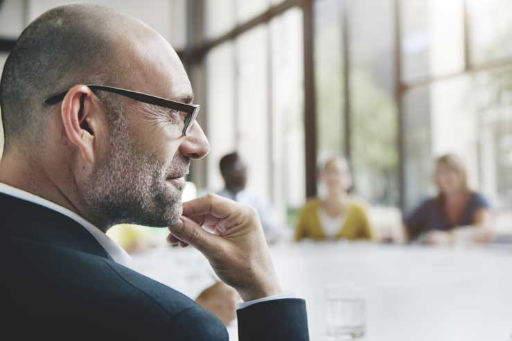 Business consultant listening intently during a meeting