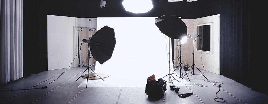 Photography set with a white background and 3 point lighting setup