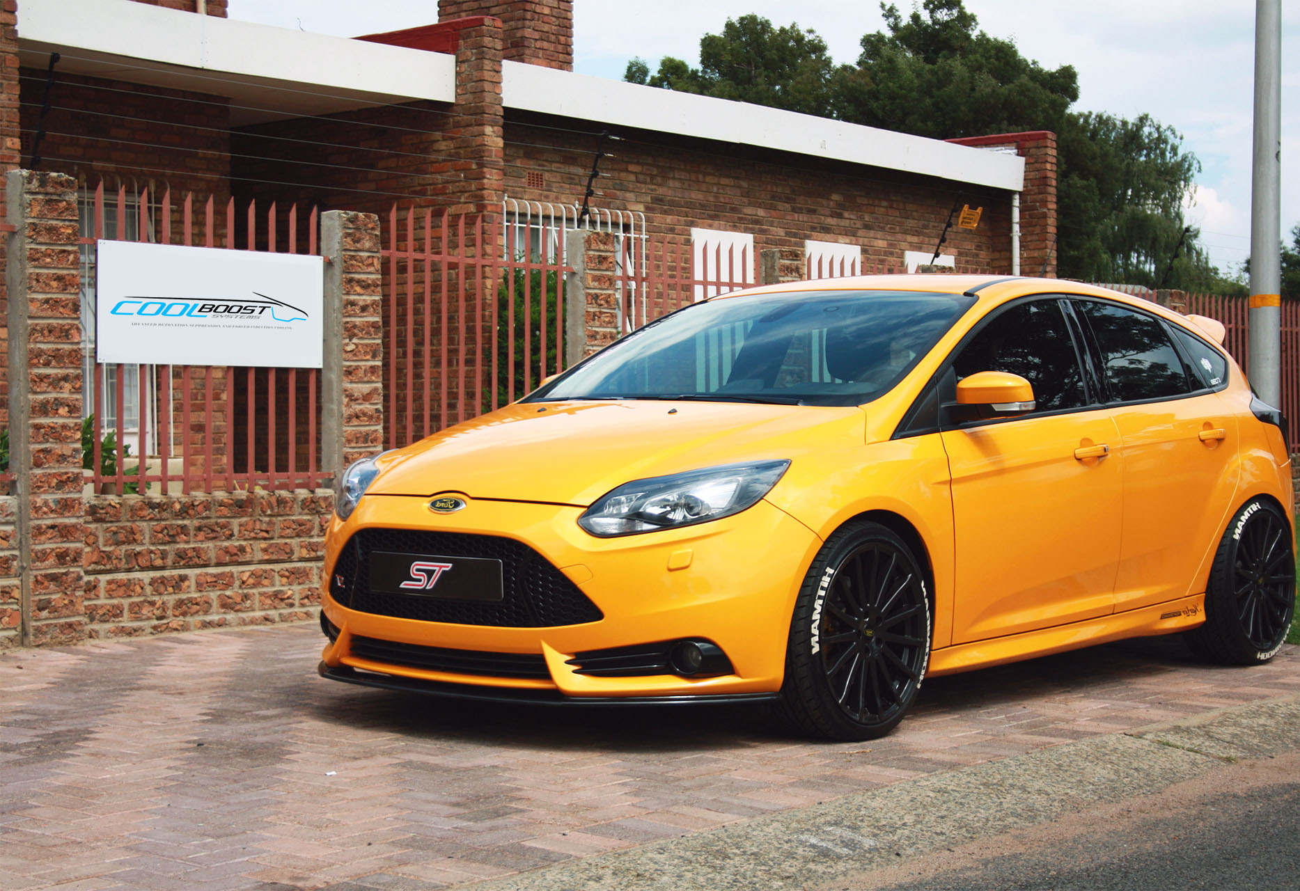 Yellow ford focus ST parked outside the cool boost systems head office